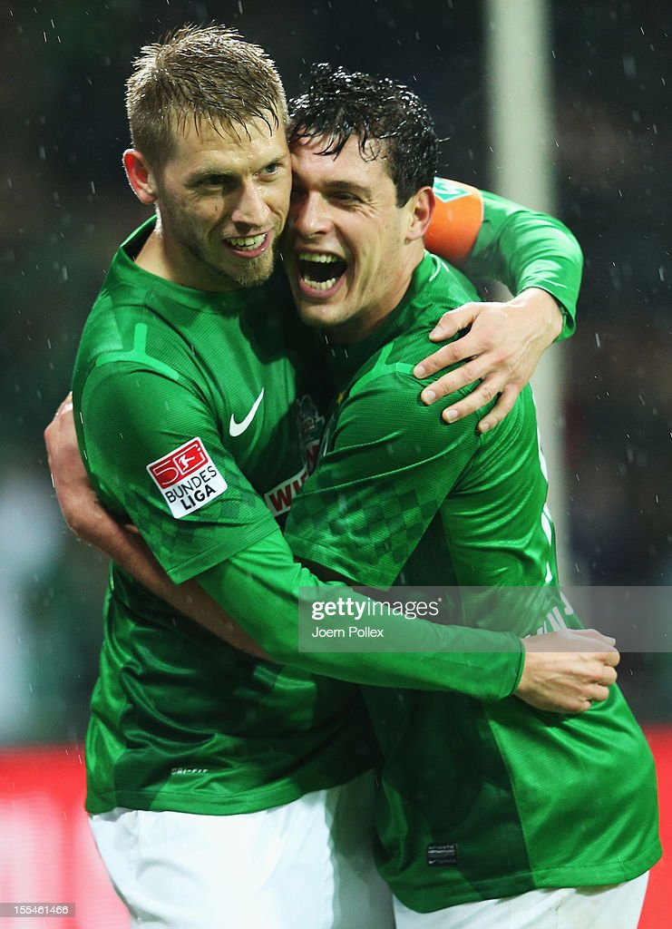 Aaron Hunt (L) of Bremen celebrates with his team mate Zlatko Junuzovic after scoring his team's first goal during the Bundesliga match between SV Werder Bremen and 1. FSV Mainz 05 at Weser Stadium on November 4, 2012 in Bremen, Germany.
