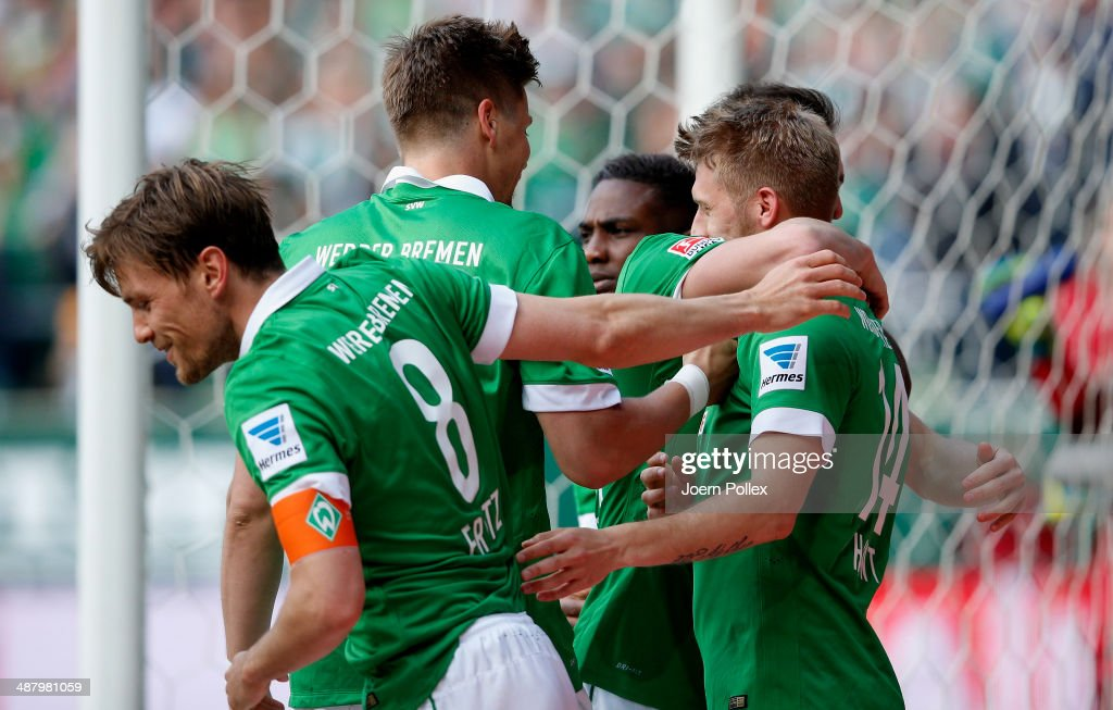 Aaron Hunt (R) of Bremen celebrates with his team mates after he scored his team's first goall during the Bundesliga match between Werder Bremen and Hertha BSC at Weserstadion on May 3, 2014 in Bremen, Germany.