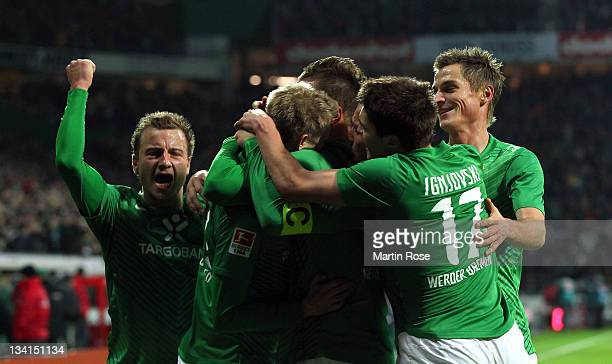 Aaron Hunt of Bremen celebrates with his team mates after he scores his team's opening goal during the Bundesliga match between Werder Bremen and VfB...