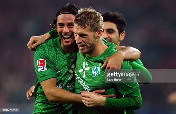 Aaron Hunt of Bremen celebrates with team mate Claudio Pizarro after scoring his teams second goal during the Bundesliga match between FSV Mainz 05...