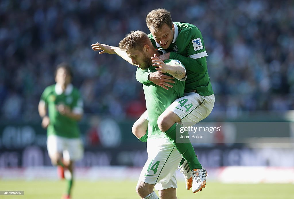 Aaron Hunt (L) of Bremen celebrates with team mate Philipp Bargfrede after he scored his team's second goall during the Bundesliga match between Werder Bremen and Hertha BSC at Weserstadion on May 3, 2014 in Bremen, Germany.