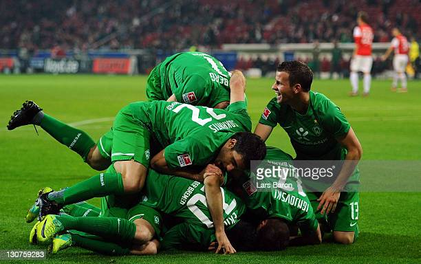 Aaron Hunt of Bremen celebrates with team mates after scoring his teams second goal during the Bundesliga match between FSV Mainz 05 and SV Werder...