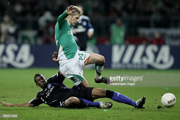 Aaron Hunt of Bremen fights for the ball with Jerome Boateng of Hamburg during the Bundesliga match between Werder Bremen and Hamburger SV at the...