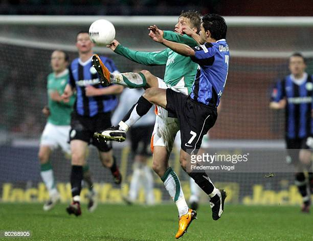Aaron Hunt of Bremen fights for the ball with Josue of Wolfsburg during the Bundesliga match between Werder Bremen and VfL Wolfsburg at the Weser...