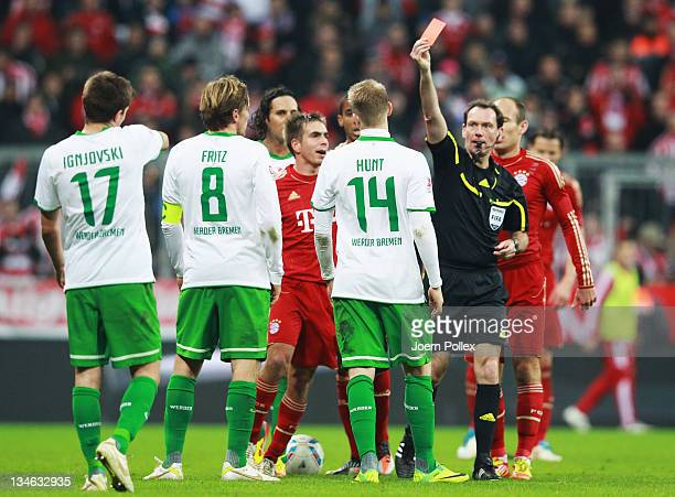 Aaron Hunt of Bremen gets the red card from referee Florian Meyer during the Bundesliga match between FC Bayern Muenchen and SV Werder Bremen at...