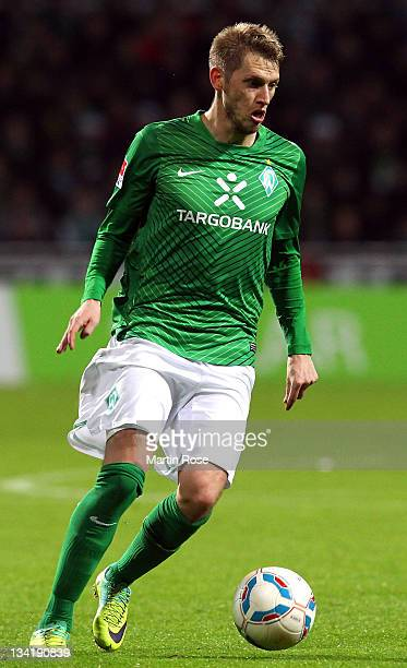 Aaron Hunt of Bremen runs with the ball during the Bundesliga match between Werder Bremen and VfB Stuttgart at Weser Stadium on November 27, 2011 in...