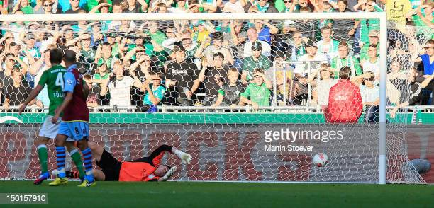 Aaron Hunt of Bremen scores during a preseason friendly match between Werder Bremen and Aston Villa at Weserstadion on August 11 2012 in Bremen...