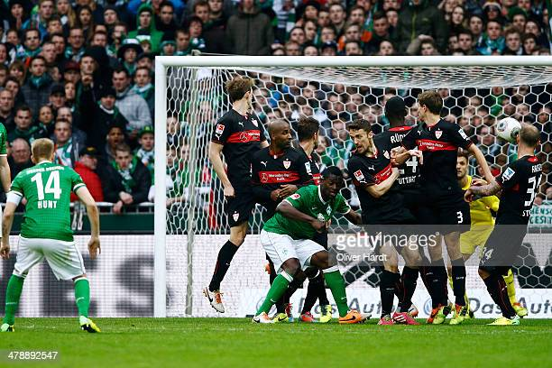 Aaron Hunt of Bremen scores his first goal during the Bundesliga match between Werder Bremen and Hamburger SV at Weserstadion on March 15, 2014 in...