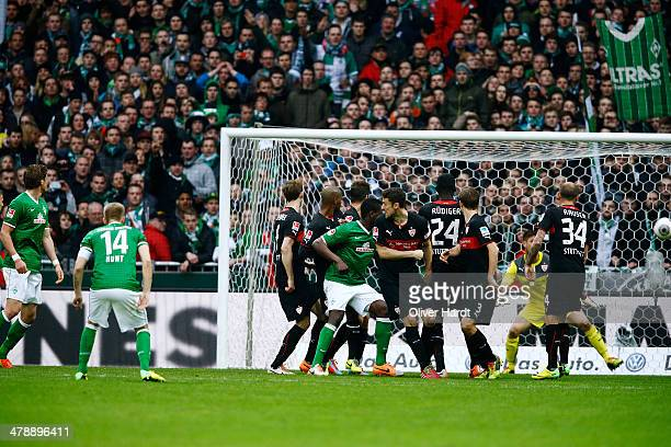 Aaron Hunt of Bremen scores his first goal during the Bundesliga match between Werder Bremen and VfB Stuttgart at Weserstadion on March 15, 2014 in...