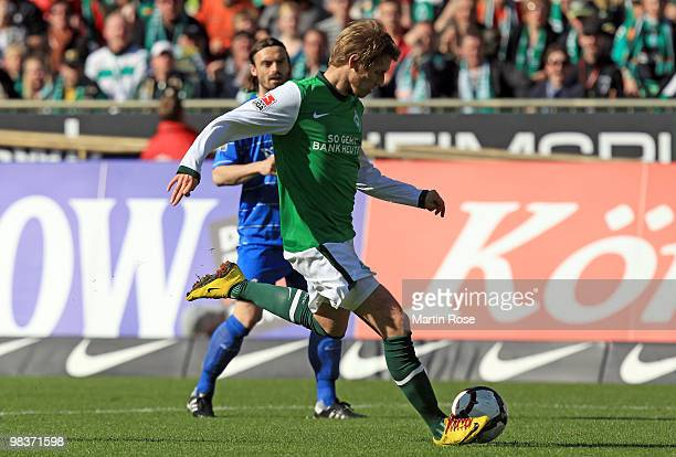 Aaron Hunt of Bremen scores his team's 2nd goal during the Bundesliga match between Werder Bremen and SC Freiburg at the Weser Stadium on April 10...