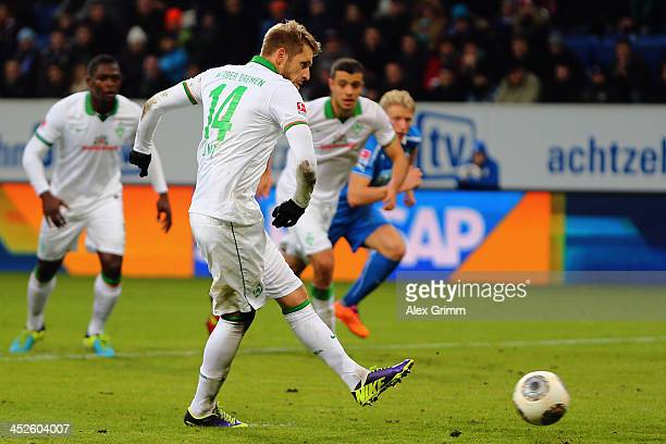 Aaron Hunt of Bremen scores his team's first goal with a penalty during the Bundesliga match between 1899 Hoffenheim and Werder Bremen on November...