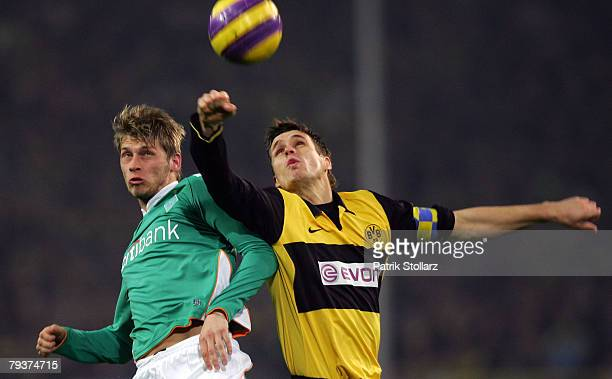 Aaron Hunt of Bremen tackles Sebastian Kehl of Dortmund during the DFB Cup Round of 16 match between Borussia Dortmund and Werder Bremen at the...