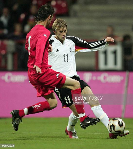 Aaron Hunt of Germany and Byron Anthony of Wales fight for the ball during the Under 21 European Championship Qualifier match between Germany and...
