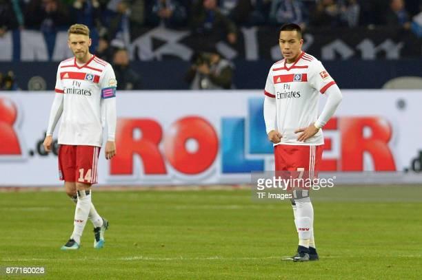 Aaron Hunt of Hamburg and Bobby Wood of Hamburg looks dejected during the Bundesliga match between FC Schalke 04 and Hamburger SV at VeltinsArena on...
