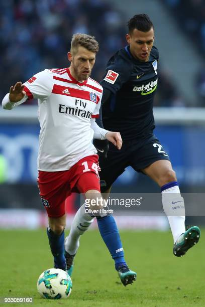 Aaron Hunt of Hamburg and Davie Selke of Berlin compete for the ball during the Bundesliga match between Hamburger SV and Hertha BSC at...