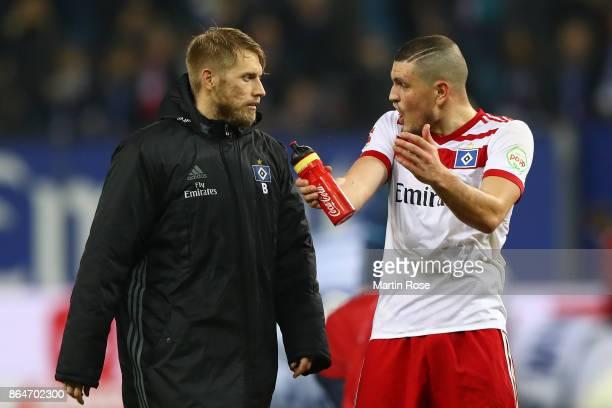 Aaron Hunt of Hamburg and Kyriakos Papadopoulos of Hamburg talk after the Bundesliga match between Hamburger SV and FC Bayern Muenchen at...