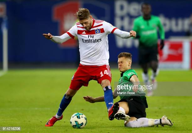 Aaron Hunt of Hamburg and Matthias Ostrzolek of Hannover battle for the ball during the Bundesliga match between Hamburger SV and Hannover 96 at...