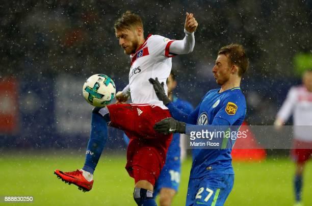 Aaron Hunt of Hamburg and Maximilian Arnold of Wolfsburg battle for the ball during the Bundesliga match between Hamburger SV and VfL Wolfsburg at...