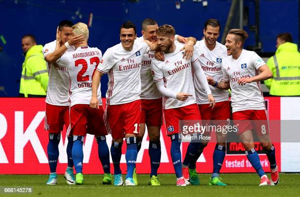Aaron Hunt of Hamburg celebrate with his team mates after scoring the opening goal during the Bundesliga match between Hamburger SV and TSG 1899...
