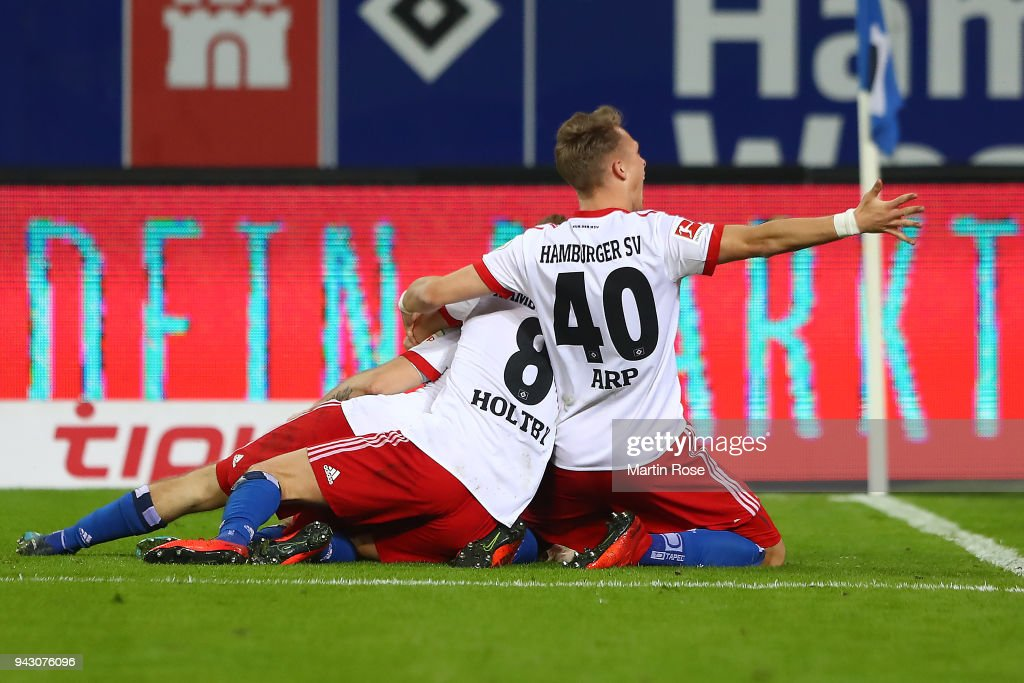 Aaron Hunt of Hamburg (covered) celebrates with his team after he scored a goal to make it 3:2 during the Bundesliga match between Hamburger SV and FC Schalke 04 at Volksparkstadion on April 7, 2018 in Hamburg, Germany.