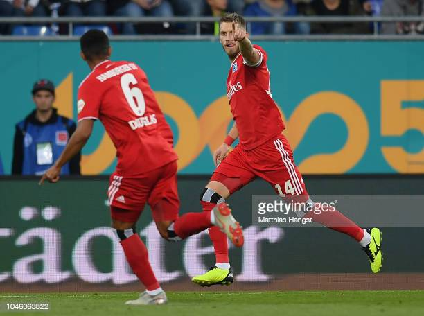 Aaron Hunt of Hamburg celebrates with his teammates after scoring his team's first goal during the Second Bundesliga match between SV Darmstadt 98...