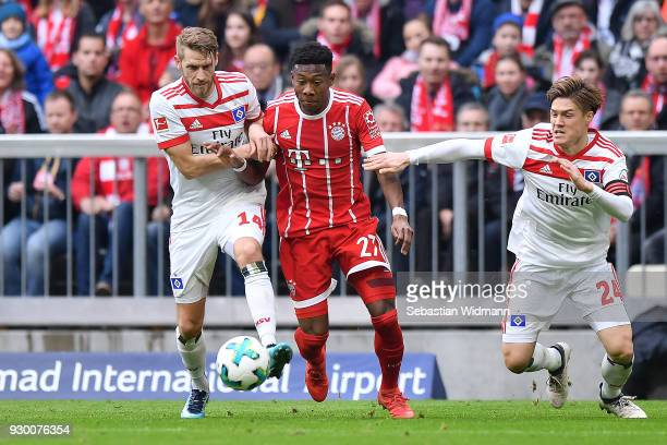 Aaron Hunt of Hamburg David Alaba of Bayern Muenchen and Gotoku Sakai of Hamburg fight the ball during the Bundesliga match between FC Bayern...