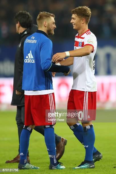 Aaron Hunt of Hamburg embraces JannFiete Arp of Hamburg after the Bundesliga match between Hamburger SV and VfB Stuttgart at Volksparkstadion on...
