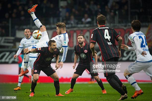 Aaron Hunt of Hamburg falls over Szabolcs Huszti of Frankfurt during the Bundesliga match between Eintracht Frankfurt and Hamburger SV at...