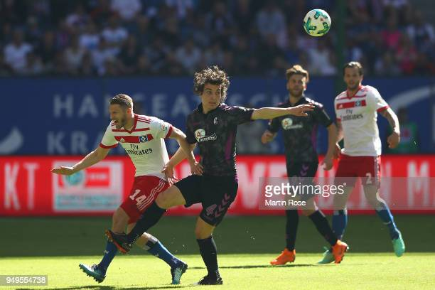 Aaron Hunt of Hamburg fights for the ball with Caglar Soeyuencue of Freiburg during the Bundesliga match between Hamburger SV and SportClub Freiburg...