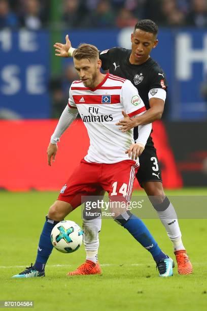 Aaron Hunt of Hamburg fights for the ball with Dennis Aogo of Stuttgart during the Bundesliga match between Hamburger SV and VfB Stuttgart at...