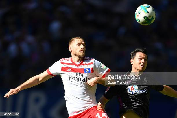 Aaron Hunt of Hamburg fights for the ball with Nicolas Hoefler of Freiburg during the Bundesliga match between Hamburger SV and SportClub Freiburg at...