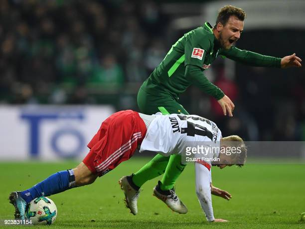 Aaron Hunt of Hamburg fights for the ball with Philipp Bargfrede of Bremen during the Bundesliga match between SV Werder Bremen and Hamburger SV at...