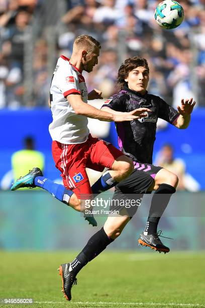Aaron Hunt of Hamburg fits for the ball with Caglar Soeyuencue of Freiburg during the Bundesliga match between Hamburger SV and SportClub Freiburg at...