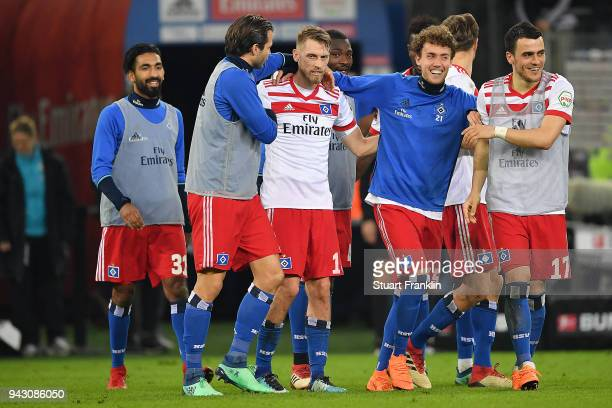 Aaron Hunt of Hamburg is celebrated by his team mates after the Bundesliga match between Hamburger SV and FC Schalke 04 at Volksparkstadion on April...
