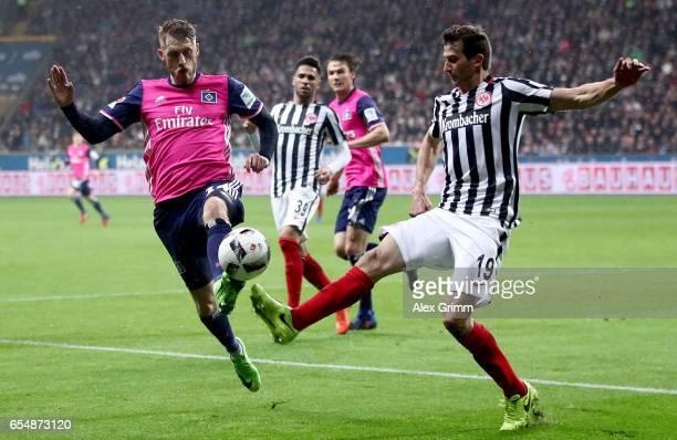 Aaron Hunt of Hamburg is challenged by David Abraham of Frankfurt during the Bundesliga match between Eintracht Frankfurt and Hamburger SV at...