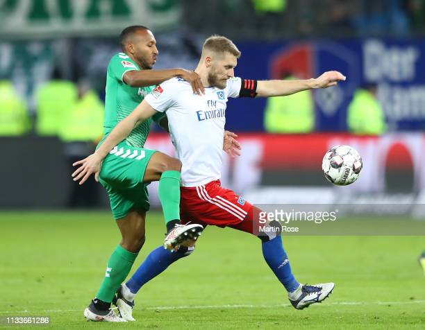 Aaron Hunt of Hamburg is challenged by Julian Green of Fuerth during the Second Bundesliga match between Hamburger SV and SpVgg Greuther Fuerth at...