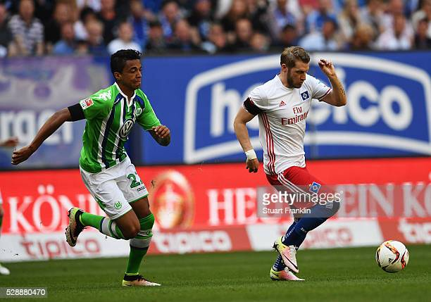 Aaron Hunt of Hamburg is challenged by Luiz Gustavo of Wolfsburg during the Bundesliga match between Hamburger SV and VfL Wolfsburg at the Volkspark...