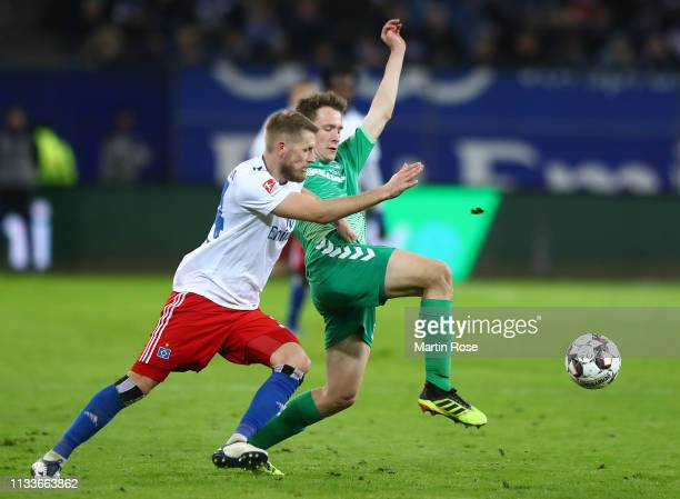 Aaron Hunt of Hamburg is challenged by Paul Jäckel of Fuerth during the Second Bundesliga match between Hamburger SV and SpVgg Greuther Fuerth at...