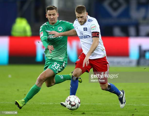 Aaron Hunt of Hamburg is challenged by Paul Seguin of Fuerth during the Second Bundesliga match between Hamburger SV and SpVgg Greuther Fuerth at...
