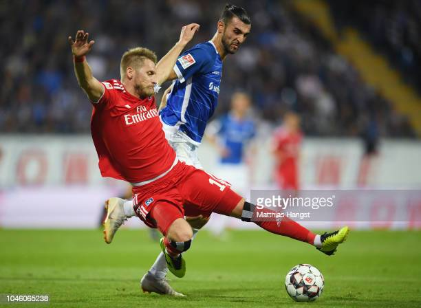 Aaron Hunt of Hamburg is challenged by Serdar Dursun of Darmstadt during the Second Bundesliga match between SV Darmstadt 98 and Hamburger SV at...
