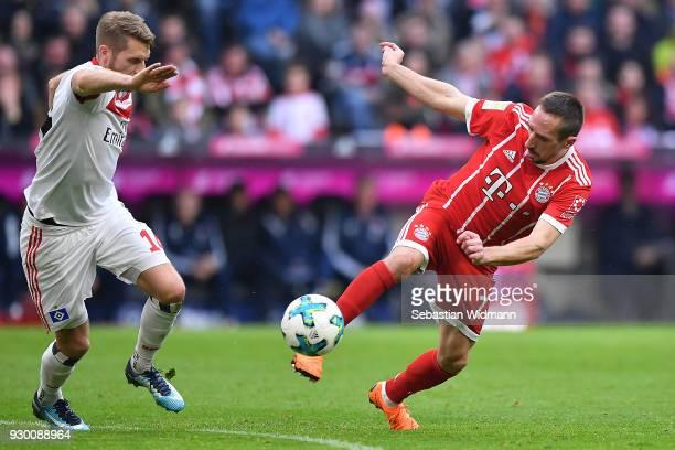 Aaron Hunt of Hamburg looks on as Franck Ribery of Bayern Muenchen takes a shot during the Bundesliga match between FC Bayern Muenchen and Hamburger...