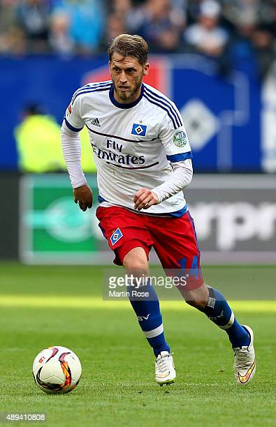 Aaron Hunt of Hamburg runs with the ball during the Bundesliga match between Hamburger SV and Eintracht Frankfurt at Volksparkstadion on September 19...