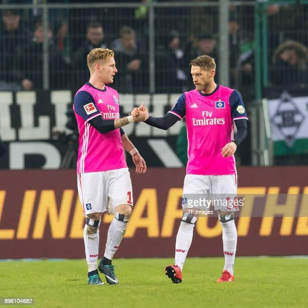 Aaron Hunt of Hamburg shakes hands with Andre Hahn of Hamburg during the Bundesliga match between Borussia Moenchengladbach and Hamburger SV at...