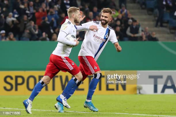 Aaron Hunt of Hamburger SV celebrates after scoring his team's first goal from the penalty spot with Lukas Hinterseer of Hamburger SV during the DFB...