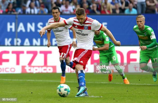 Aaron Hunt of Hamburger SV scores his sides first goal from the penalty spot during the Bundesliga match between Hamburger SV and Borussia...