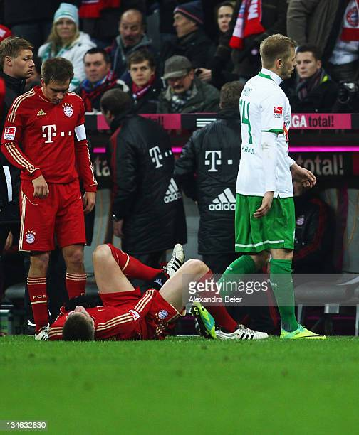 Aaron Hunt of Werder Bremen walks behind Toni Kroos and Philipp Lahm of Bayern Muenchen after he received a red card during the Bundesliga match...