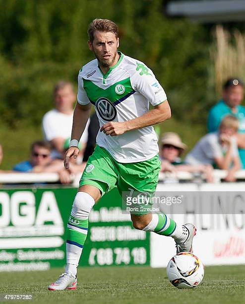Aaron Hunt of Wolfsburg runs with the ball during the friendly match between VfL Wolfsburg and Team Veltins at GWGStadion Flutmulde on July 4 2015 in...