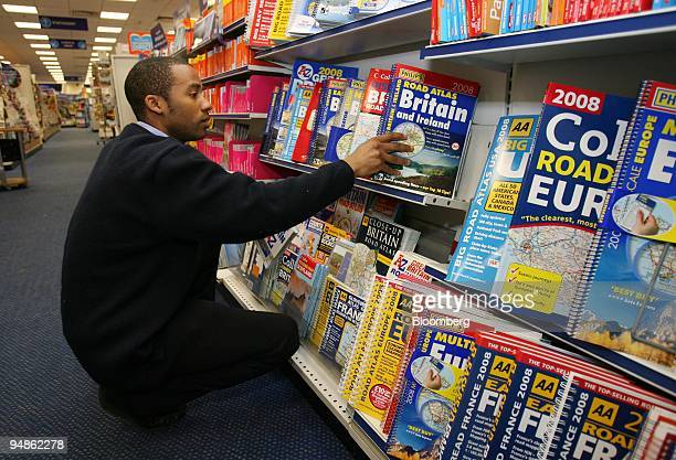 Aaron Hunter an employee staightens a shelf of road maps at a WH Smith shop in London UK on Tuesday April 15 2008 The UK's largest magazine retailer...