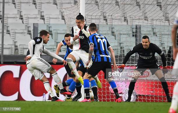 Aaron James Ramsey of Juventus scores the opening goal during the Serie A match between Juventus and FC Internazionale played behind closed doors at...