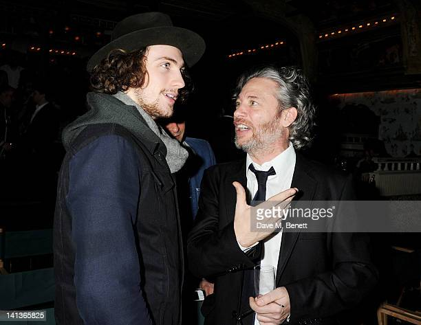 Aaron Johnson and Dexter Fletcher attend a private screening of Dexter Fletcher's directorial debut 'Wild Bill' hosted by chef Jamie Oliver at The...